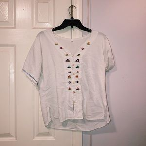 White peasant top with floral embroidery